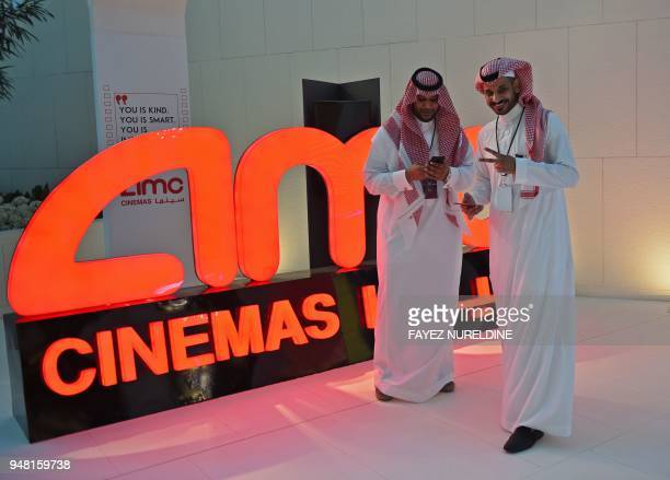 A Saudi man poses for a photograph during a cinema test screening in Riyadh on April 18 2018 Blockbuster action flick 'Black Panther' play at a...