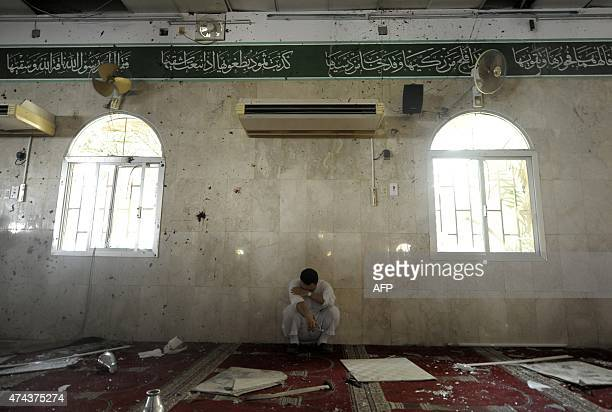 A Saudi man reacts following a blast inside a mosque in the mainly Shiite Saudi Gulf coastal town of Qatif 400 kms east of Riyadh on May 22 2015 A...