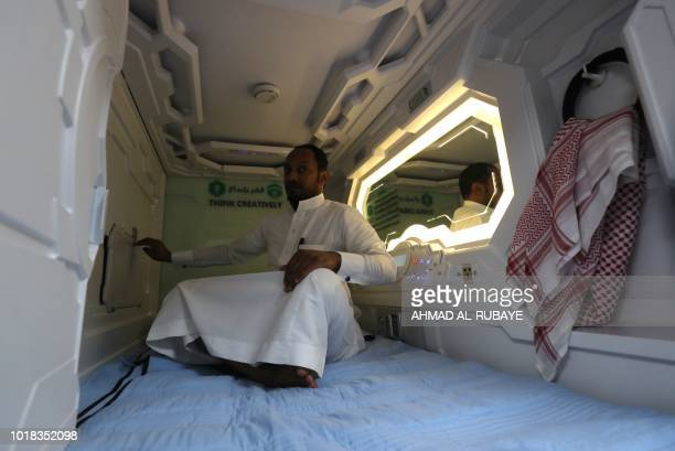 A Saudi man sits inside of a sleep pod in Mecca on August 16 2018 The free nap pods are part of new measures Saudi Arabia is rolling out this year in...