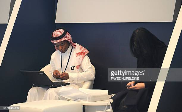 A Saudi man sits near a woman as he works on his laptop at a hotel in Riyadh on January 22 2012 The head of Saudi Arabia's powerful religious police...