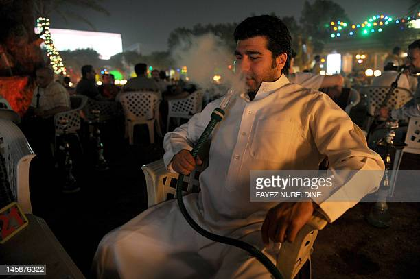 Saudi man smokes a waterpipe at a cafe in Riyadh on June 5 2012 Saudis face the spectre of unemployment as the oilrich kingdom home to millions of...