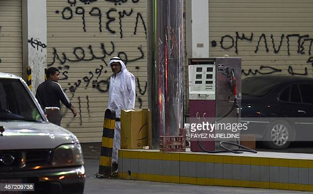 A Saudi man walks at a petrol station where a shooting attack took place earlier in the Saudi capital Riyadh on October 14 2014 The gunman who shot...