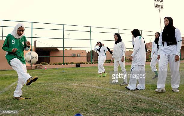 Saudi members of the King's United women football club train at a stadium in the Red sea port of Jeddah on May 20 despite strict religious taboos in...