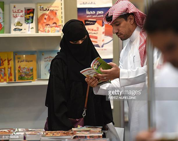 Saudi men and women browse the annual Riyadh International Book Exhibition in the capital Riyadh on March 17 2016 Over 500 publishing houses and more...
