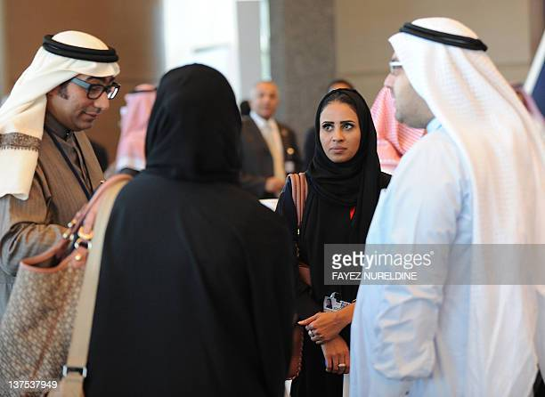 Saudi men and women chat at a hotel in Riyadh on January 22 2012 The head of Saudi Arabia's powerful religious police was recently replaced with a...
