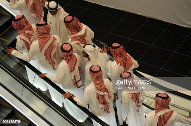 Saudi men arrive at a cinema theatre in Riyadh Park mall after its opening for the general public on April 30 2018 in the Saudi capital Saudi Arabia...