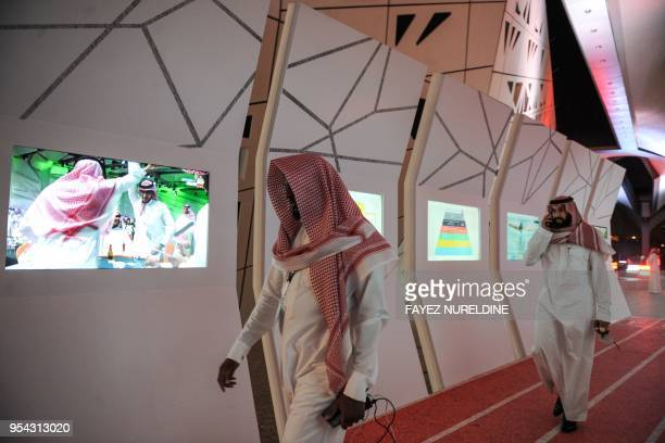 Saudi men arrive to attend the Quality of Life Program 2020 conference in the capital Riyadh on May 3 2018 The program is one of the vision...