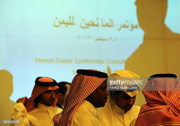 Saudi men attend the international donor meeting for Yemen in Riyadh on September 4 2012 Saudi Arabia called for aid to help its impoverished...