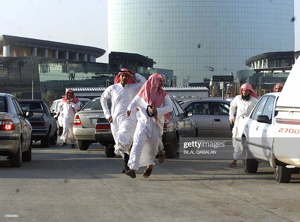 Saudi men flee from police during a prot : News Photo