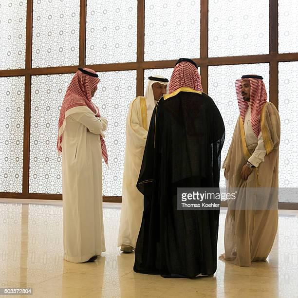 Saudi men on the edge of political talks on October 19 2015 in Riad Saudi Arabia