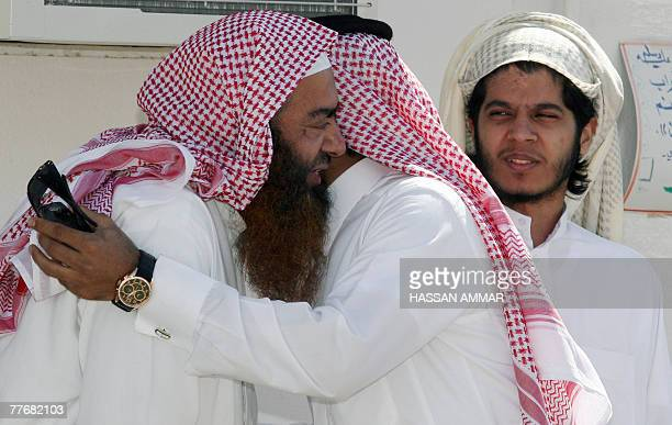 Saudi men released from the US Guantanamo Bay detentioncentre as well as prisons in Iraq and Saudi Arabia listen greet each other at an interior...