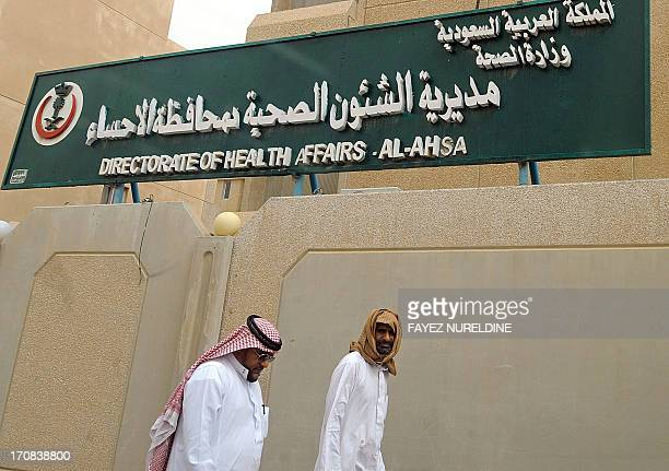 Saudi men walk to the King Fahad hospital in the city of Hofuf some 370 kilometres East of the capital Riyadh on June 16 2013 In the East of Saudi...