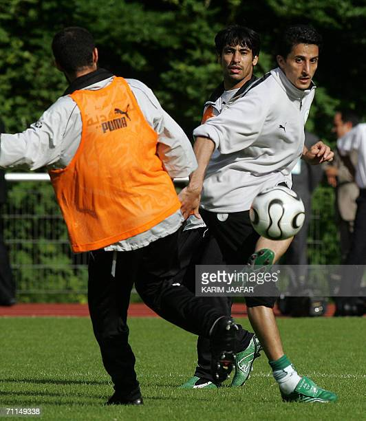 Saudi midfielder Nawaf alTemyat fights for the ball with defender Abdulaziz Khathran and defender Hussein Sulimani a training session at Bad Nauheim...