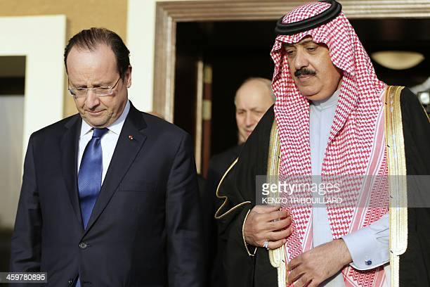 Saudi Minister of National Guard Mutaib bin Abdullah and French President Francois Hollande leave after a meeting in Riyadh on December 30 2013...