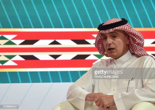 Saudi minister of state for foreign affairs Adel alJubeir addresses a panel labelled G20 to reconnect the world at the International Media Centre in...