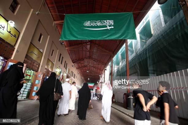 A Saudi national flag is seen hanging in the traditional Mubarakiya Market in Kuwait City on September 23 2017 on the anniversary of the founding of...