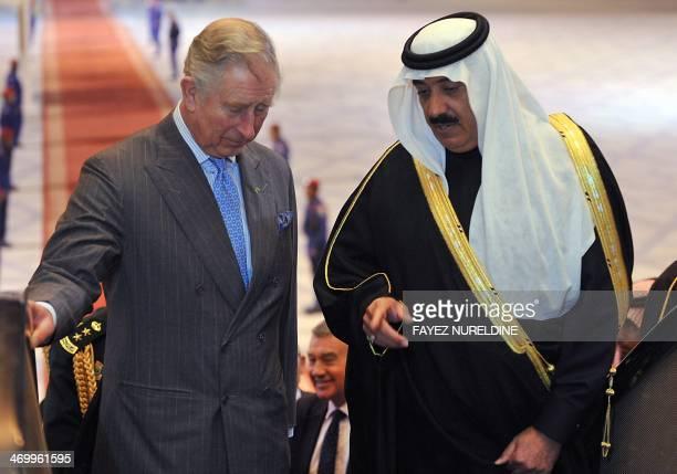 Saudi National Guard Minister Mutaib bin Abdullah bin Abdulaziz talks to Britain's Prince Charles on February 17 2014 following the latter's arrival...