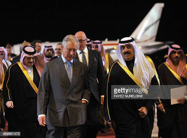 Saudi National Guard Minister Mutaib bin Abdullah bin Abdulaziz walks alongside Britain's Prince Charles on February 17 2014 following the latter's...