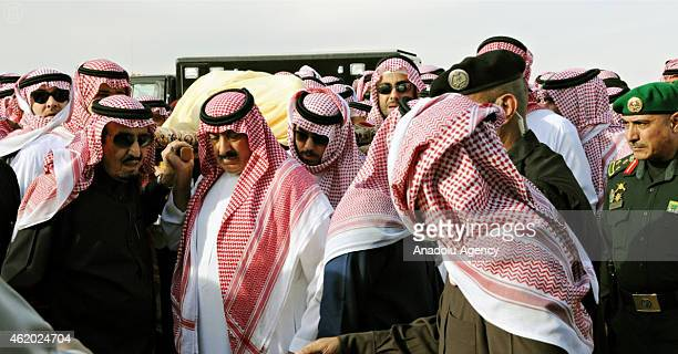 Saudi new King Salman bin Abdul Aziz is seen as mourners and family members burying the body of the late Saudi King Abdullah bin Abdulaziz alSaud at...