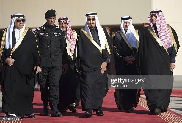 Saudi new King Salman Crown Prince Moqren bin Abdul Aziz and deputy Crown Prince and Interior Minister Mohammed bin Nayef walk to greet US President...