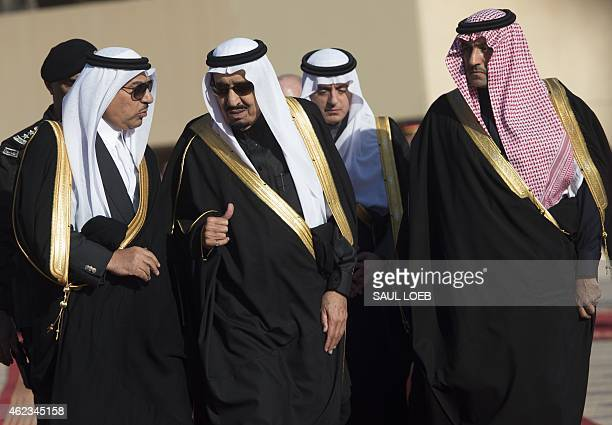 Saudi new King Salman speaks with Crown Prince and Interior Minister Mohammed bin Nayef as they walk to greet US President Barack Obama and First...