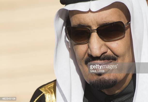 Saudi new King Salman stands during the arrival of US President Barack Obama and First Lady Michelle Obama at King Khalid International Airport in...