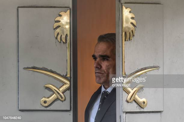 Saudi official looks through the door of the Saudi Arabian consulate in Istanbul on October 8, 2018 in Istanbul during a demonstration for missing...