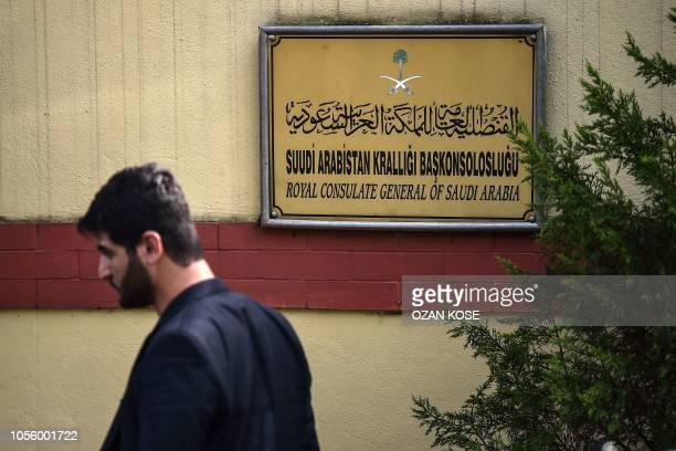 A Saudi official walks in front of the door of the Saudi Arabian consulate on November 1 2018 in Istanbul Journalist Jamal Khashoggi was strangled as...