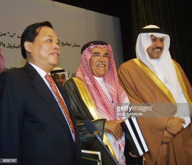 Saudi Oil Minister Ali alNuaimi Abdullah Jumah president and CEO of Saudi Aramco and Chinese Wang Jiming president of Sinopec oil company pose for a...