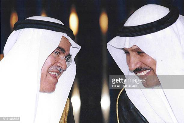 Saudi Oil Minister Ali alNuaimi talks to Abdullah Jumaa the president of the kingdom's oil giant Aramco after the opening of a conference on...