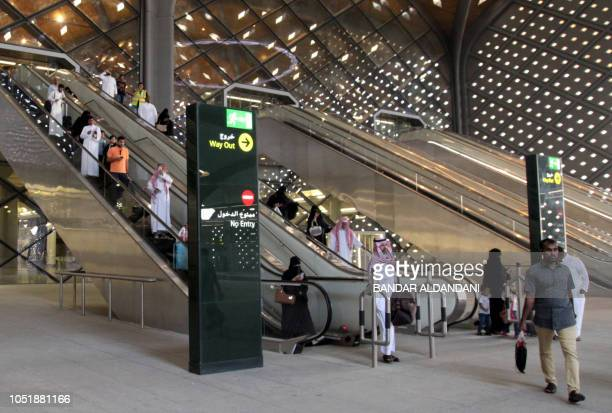 Saudi passengers are seen at Mecca's train station on October 11 2018 as the new highspeed railway line linking Mecca and Medina opens The Haramain...