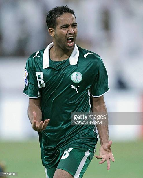 Saudi player Abdo Autef celebrates after scoring a goal against the United Arab Emirates during their World Cup 2010 qualifiying match on September...