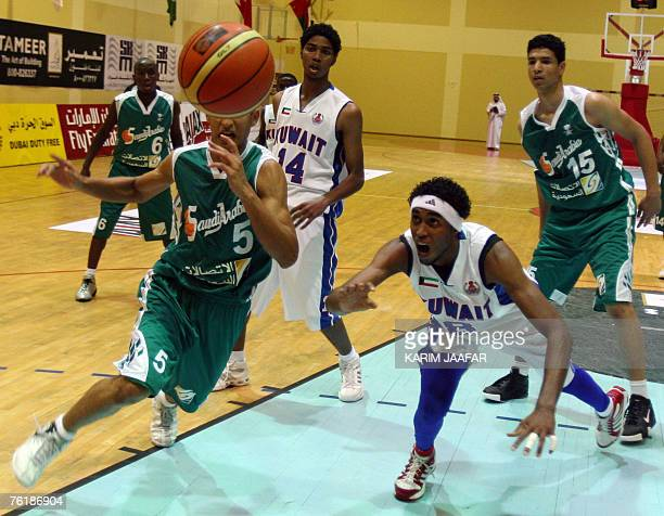Saudi player Fawzan Hassan vies with Abdulla Tawfiq of Kuwait during their basketball match for the 11th GCC youth basketball championship in the...