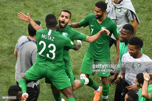TOPSHOT Saudi players celebrate their win during the Russia 2018 World Cup Group A football match between Saudi Arabia and Egypt at the Volgograd...