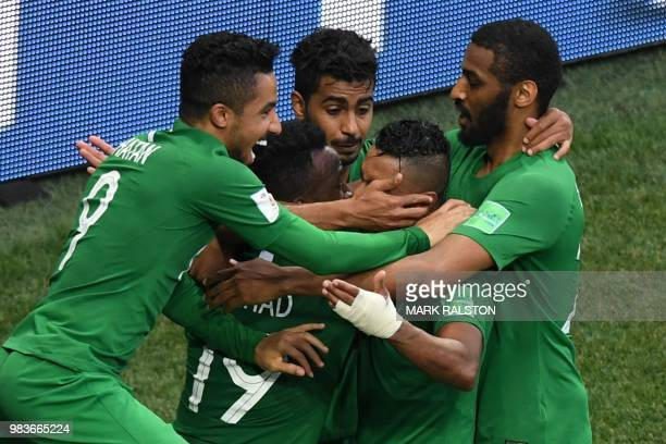 Saudi players celebrate their winning goal during the Russia 2018 World Cup Group A football match between Saudi Arabia and Egypt at the Volgograd...