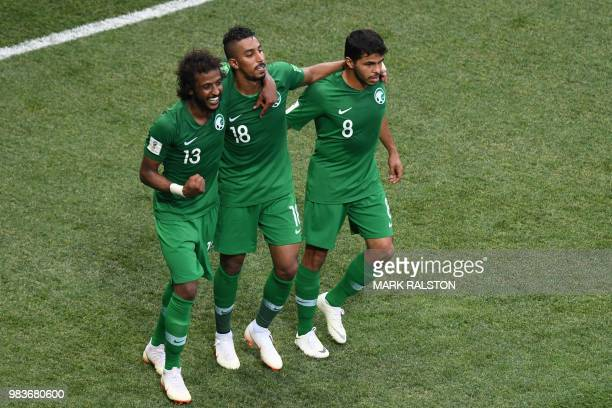 TOPSHOT Saudi players celebrate their winning goal during the Russia 2018 World Cup Group A football match between Saudi Arabia and Egypt at the...