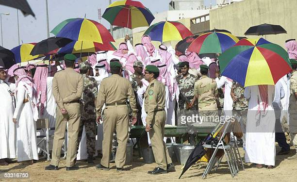 Saudi Police stand outside the Imam Turki bin Abdullah mosque during the funeral of late King Fahd in Riyadh 02 August 2005 Fahd died yesterday after...