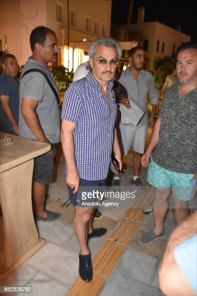 Saudi Prince AlWaleed Bin Talal bin Abdulaziz al Saud arrives at a restaurant at Marina district with Advisor to the Turkish Prime Ministry Taha Genc...