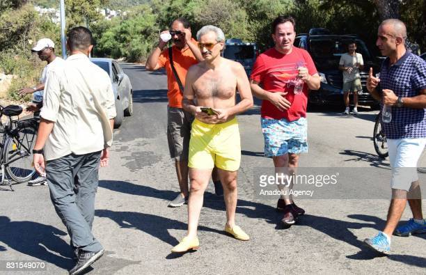Saudi Prince AlWaleed Bin Talal bin Abdulaziz al Saud is seen along with his bodyguards and fellows in the Aegean sea resort of Bodrum of Mugla...