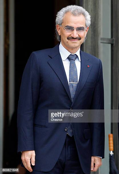 Saudi Prince Alwaleed bin Talal bin Abdulaziz Al Saud leaves after his meeting with French President Francois Hollande at the Elysee Presidential...