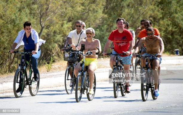Saudi Prince AlWaleed Bin Talal bin Abdulaziz al Saud rides bicycle along with his bodyguards and fellows in the Aegean sea resort of Bodrum of Mugla...