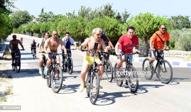 Saudi Prince AlWaleed Bin Talal bin Abdulaziz al Saud rides bicycle along with his bodyguards and fellows in the Aegean sea resort of Bodrum of Mugla...