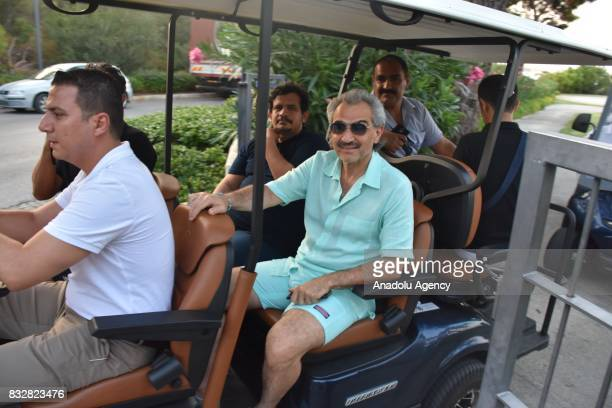 Saudi Prince AlWaleed Bin Talal bin Abdulaziz al Saud takes a buggy ride while returning to the hotel at Bodrum in Mugla Province of Turkey on August...
