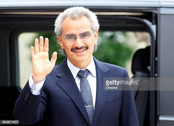 Saudi Prince Alwaleed bin Talal bin Abdulaziz Al Saud waves after his meeting with French President Francois Hollande at the Elysee Presidential...
