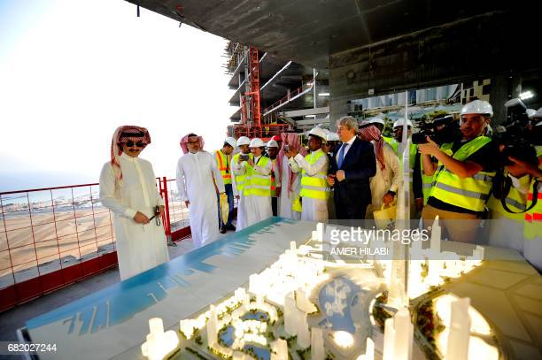Saudi Prince Alwaleed bin Talal looks at model of Jeddah Tower ahead of a press conference on May 11 in the Red Sea city of Jeddah The completion...