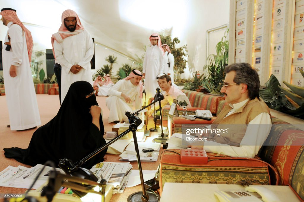 Saudi Prince Alwaleed bin Talal, right, meets citizens who have lined up to ask for the Prince's assistance during an audience at his desert camp near Riyadh, Saudi Arabia, on Wednesday, April 28, 2010. Saudi Arabias King Salman embarked on the most sweeping crackdown yet of his reign, ordering security forces to arrest senior princes including one of the worlds richest men and driving out one of the most prominent officials from his ministerial role. Those detained included billionaire Prince Alwaleed bin Talal, who was picked up at his desert camp outside Riyadh, according to a senior Saudi official. Our editors select the best archive images of Prince Alwaleed bin Talal. Photographer: Waseem Obaidi/Bloomberg via Getty Images