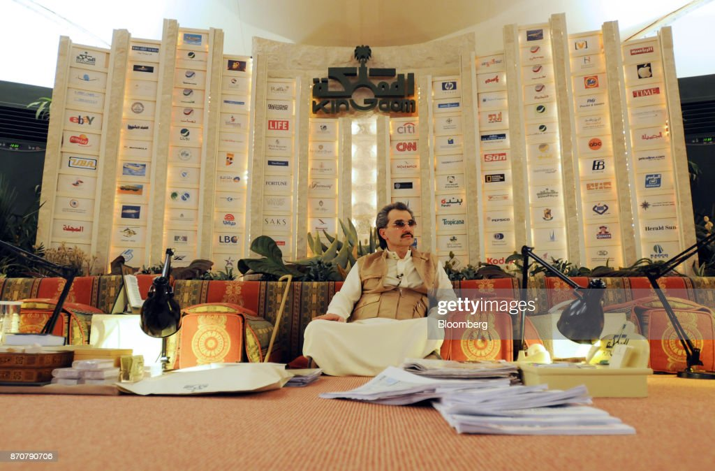 Saudi Prince Alwaleed bin Talal, sits surrounded by paperwork whilst inside his desert camp near Riyadh, Saudi Arabia, on Wednesday, April 28, 2010. Saudi Arabias King Salman embarked on the most sweeping crackdown yet of his reign, ordering security forces to arrest senior princes including one of the worlds richest men and driving out one of the most prominent officials from his ministerial role. Those detained included billionaire Prince Alwaleed bin Talal, who was picked up at his desert camp outside Riyadh, according to a senior Saudi official. Our editors select the best archive images of Prince Alwaleed bin Talal. Photographer: Waseem Obaidi/Bloomberg via Getty Images