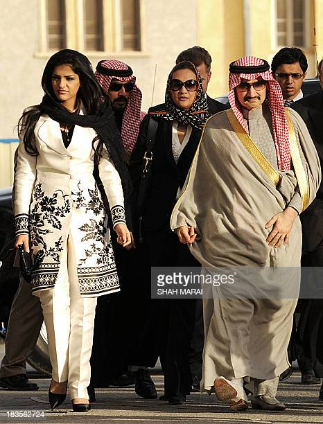 Saudi Prince AlWalid bin Talal bin Abdul Aziz Al Saud walks with his entourage and his wife Princess Ameera as he arrives at the Presidential palace...