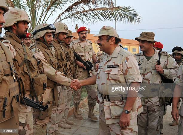 Saudi Prince Khaled bin Sultan shakes hands with soldiers as he visits the southern province of Jizan near the border with Yemen on November 7 2009...