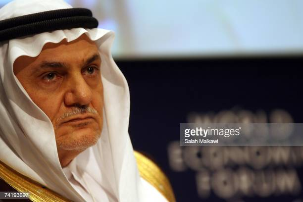 Saudi Prince Turki Al Faisal Chairman of King Faisal center for research and Islamic studies looks on during a session modorated by Queen Rania...